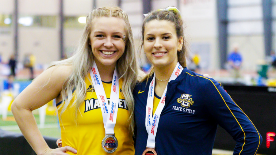 Madison Marko (left) poses with Mila Puseljic (right) after finishing in 2nd place in the long jump at the BIG EAST Indoor Championships March 2. (Photo courtesy of Marquette Athletics.)
