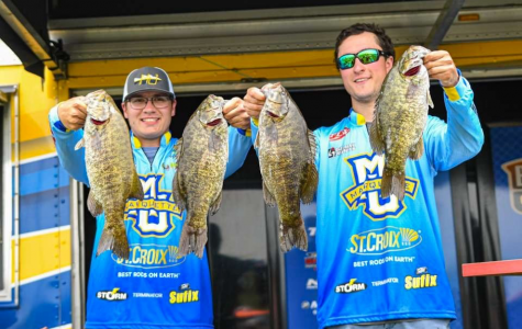 Maciek Chmielewski (left) and Michael Galeana (right) pose with their fish on St. Lawrence River in June 2019. (Photo courtesy of Michael Galeana.)