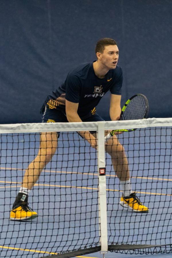 Luke Smrek prepares at the net.