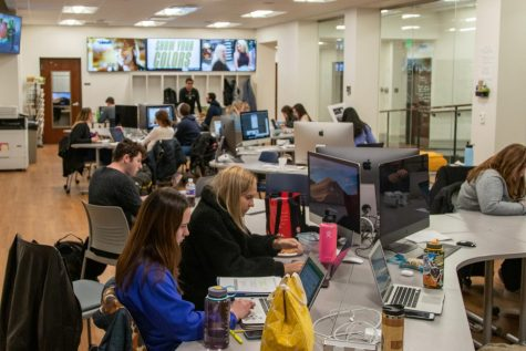 Marquette Wire reporters, editors, designers and photographers meet Dec. 2, 2019, in Johnston Hall to produce an issue of the award-winning Marquette Tribune. Marquette Wire stock photo.