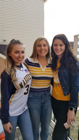 Annie Dysart (center) celebrates National Marquette Day with friends Feb. 8, 2020.