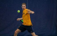 Brett Meyers hits a forehand Feb. 9 during the team's match against Valparaiso. (Photo courtesy of Marquette Athletics.)