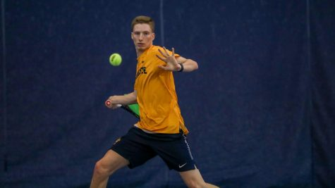 Brett Meyers hits a forehand Feb. 9 during the team
