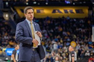 Assistant coach Jake Presutti returns to the bench after a timeout in Marquette's Dec. 28 win over Central Arkansas.