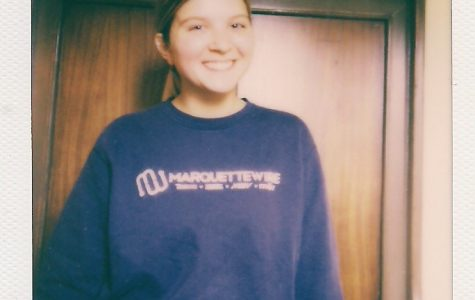 Emma Brauer sports the Marquette Wire sweatshirt she got as a first-year student.