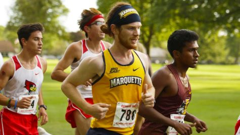 Daniel Pederson runs during cross country season. (Photo courtesy of Marquette Athletics.)