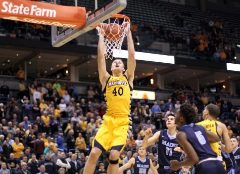Luke Fischer (40) dunks in Marquette