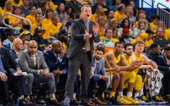 Head men's basketball coach Steve Wojciechowski coaches from the sidelines on National Marquette Day Feb. 9.