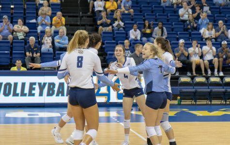 The Marquette women's volleyball team celebrates after scoring a point against Syracuse on Sep. 7, 2019.