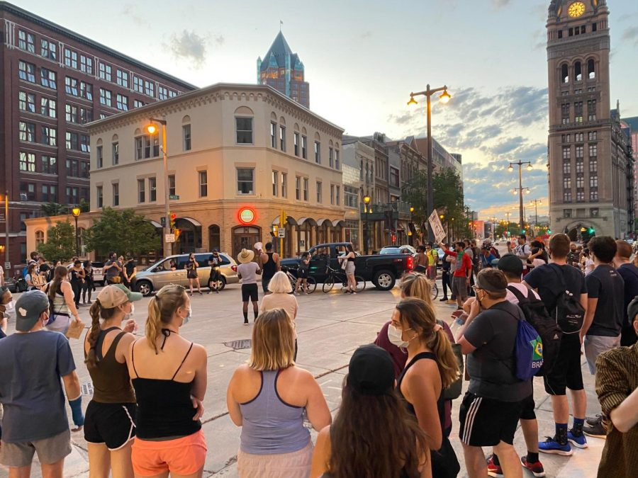 After the much larger protest at Veterans Park dispersed, a smaller crowd gathers on Mason St. to talk about safety heading into the night.