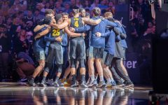 The Marquette men's basketball team gathers in a huddle before its 71-60 win over Villanova on Jan. 4.
