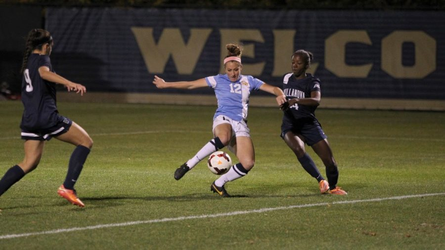 Darian Powell (12) led the Golden Eagles in both points and goals during the 2015 season. (Photo courtesy of Marquette Athletics.)