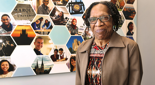 Jacqueline Walker receives Excellence in Diversity and Inclusion Award. Photo courtesy of Marquette Today.
