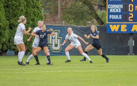 From left to right, Brianna Jaeger (7), Madison Burrier (13), and Bonnie Lacey (4) look to make a play on the ball against Utah State.