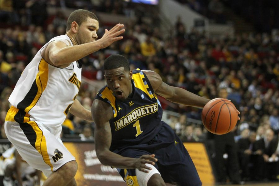 Darius Johnson-Odom dribbles the ball Nov. 2010 against University of Wisconsin-Milwaukee. (Photo courtesy of Marquette Athletics.)