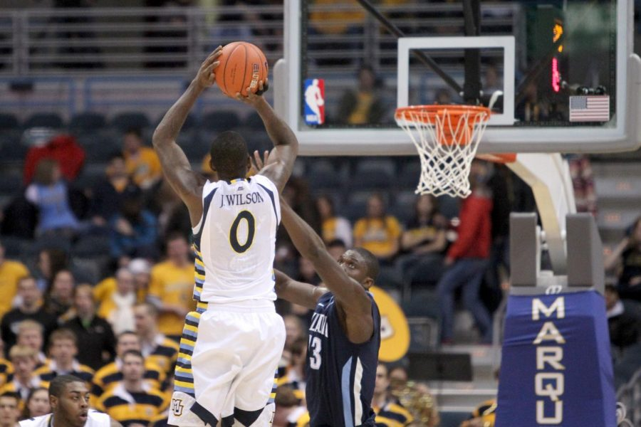 Jamil Wilson (0) shoots a basket against Villanova January 2012. (Photo courtesy of Marquette Athletics.)