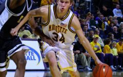 Travis Diener dribbles the ball into the lane. Diener played for Marquette from 2001 to 2005. (Photo courtesy of Marquette Athletics)