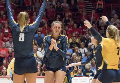 Allie Barber celebrates with teammates Hope Werch (8), Katie Schoessow (17), and Martha Konovodoff (7) in a match against Wisconsin.