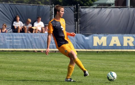 Danny Jarosz passes the ball in warmups of Marquette's exhibition game against Wright State in 2014. (Photo courtesy of Marquette Athletics.)