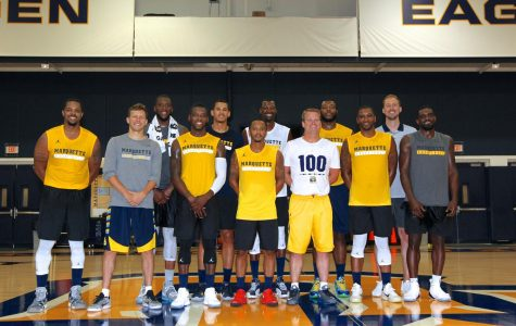 Joe Chapman (far left) and Travis Diener (to the right of Chapman) pose with the 2017 TBT team.