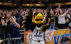 The Golden Eagle stands with the student section at the Marquette men's basketball game Dec. 4. (Photo courtesy of Marquette Athletics.)