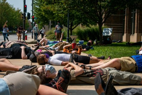 Protestors lay on the ground outside of Zilber Hall, part of the