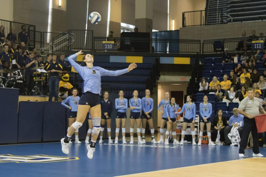 Kaitlyn+Lines+%289%29+serves+the+ball+while+her+teammates+watch+in+a+match+against+Baylor+on+Sep.+8%2C+2019.