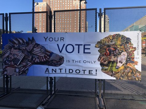 "A sign that states, ""Your Vote is the only antidote"" is on the fence outside of the Wisconsin Center."