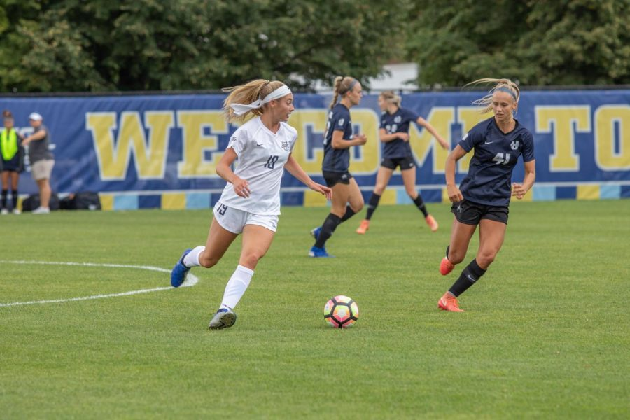 Alex Campana (19) dribbles the ball in MU's 5-1 loss to Utah State University. (Marquette Wire Stock Photo)