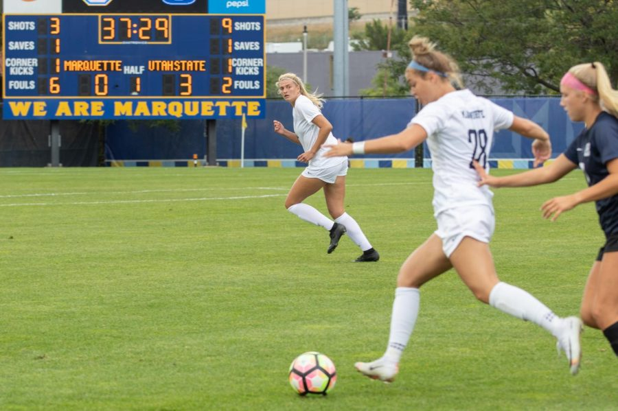 Addie Shock and Maura Weaver (28) move downfield in a game against Xavier last fall.