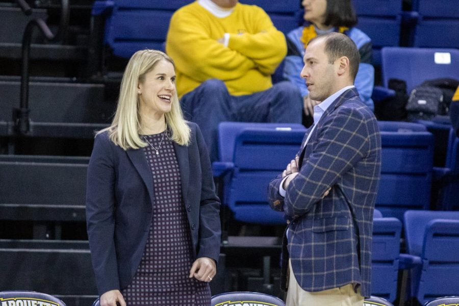 Marquette women's basketball head coach Megan Duffy speaks with Saint John's women's basketball head coach Joe Tartamella.