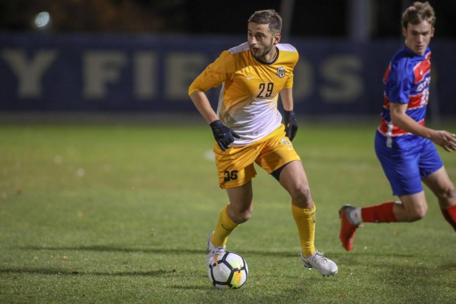 Oliver Posarelli dribbles the ball in Marquette's Senior Night game against DePaul Oct. 31, 2018. (Photo courtesy of Marquette Athletics.)