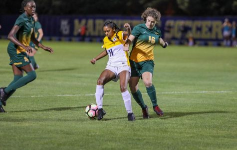 Shelby Fountain dribbles the ball in Marquette's 5-0 exhibition win against University of Regina Aug. 2019. (Photo courtesy of Marquette Athletics.)