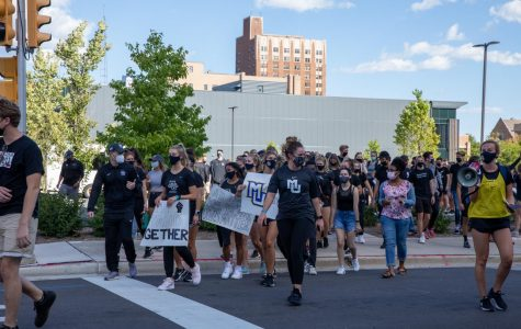 Erin Scott (front, MU short-sleeve t-shirt) walks with the women's soccer team during the athletes' march Sept. 4. (Photo courtesy of Marquette Athletics.)