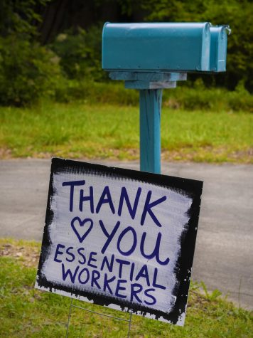 A sign showcases appreciation for essential workers. Photo via Flickr