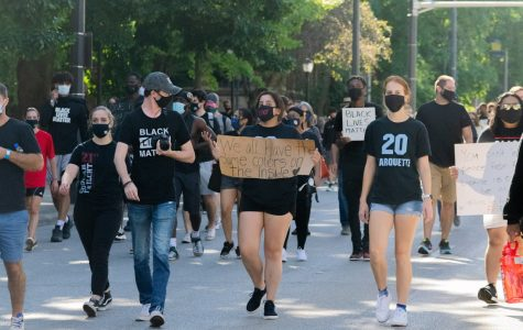 Student march alongside Marquette athletes Sept. 4.