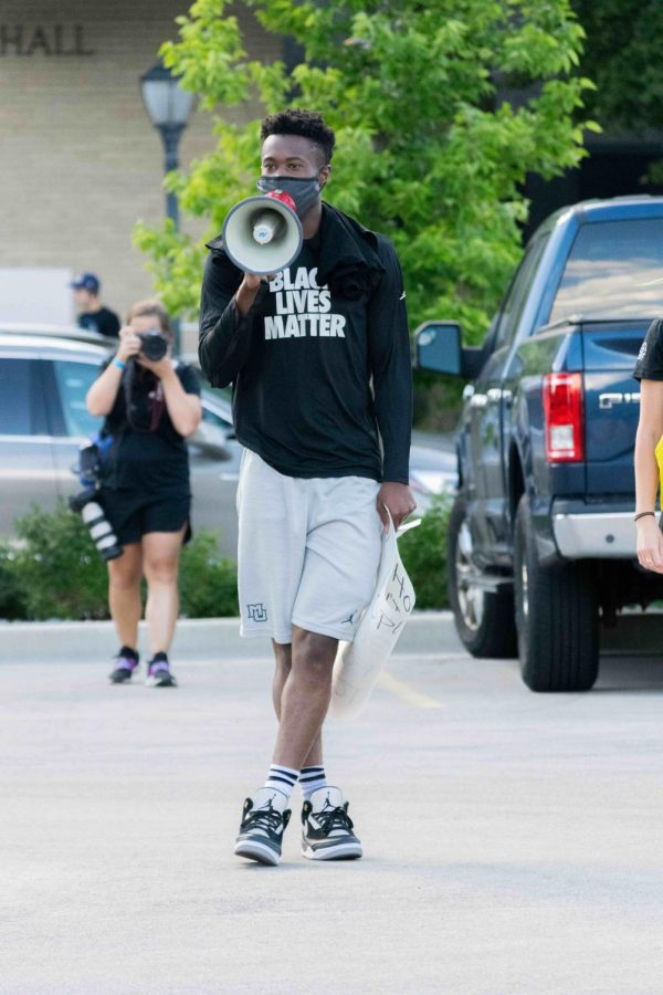 Koby McEwen started the march off with a speech through a megaphone.