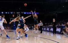 Selena Lott (24) shoots in Marquette's loss during the BIG EAST title game March 9 at Wintrust Arena.