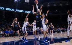 Lauren Van Kleunen (42) attempts a shot in Marquette women's basketball loss to DePaul March 9.