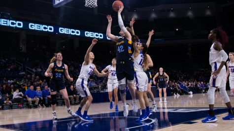 Lauren Van Kleunen (42) attempts a shot in Marquette women
