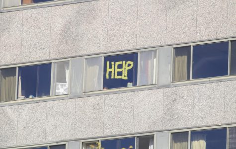 Residence of Schroeder Hall wrote notes on their windows with post-it notes.