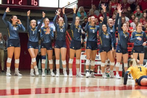 The Marquette volleyball team celebrates during a game Sept. 5, 2019 at Wisconsin.