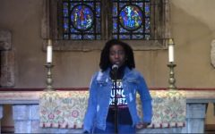 Breanna Flowers, President of Black Student Council, speaks at the prayer service.