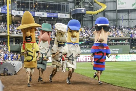 The Johnsonville sausages race during the sixth inning during the third game of the final home series between the Milwaukee Brewers and the Chicago Cubs on September 5, 2018, at Miller Park in Milwaukee, WI.