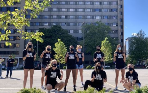 Savannah Rennie (far left) stands with the Marquette volleyball team prior to the athlete march Sept. 4. (Photo courtesy of Marquette Athletics.)