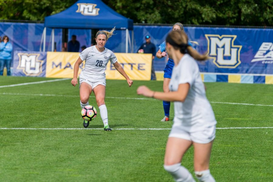 Maddie Monticello (20) attempts to make a pass in Marquette's 1-0 2OT win against Michigan on Sept. 1 2019.