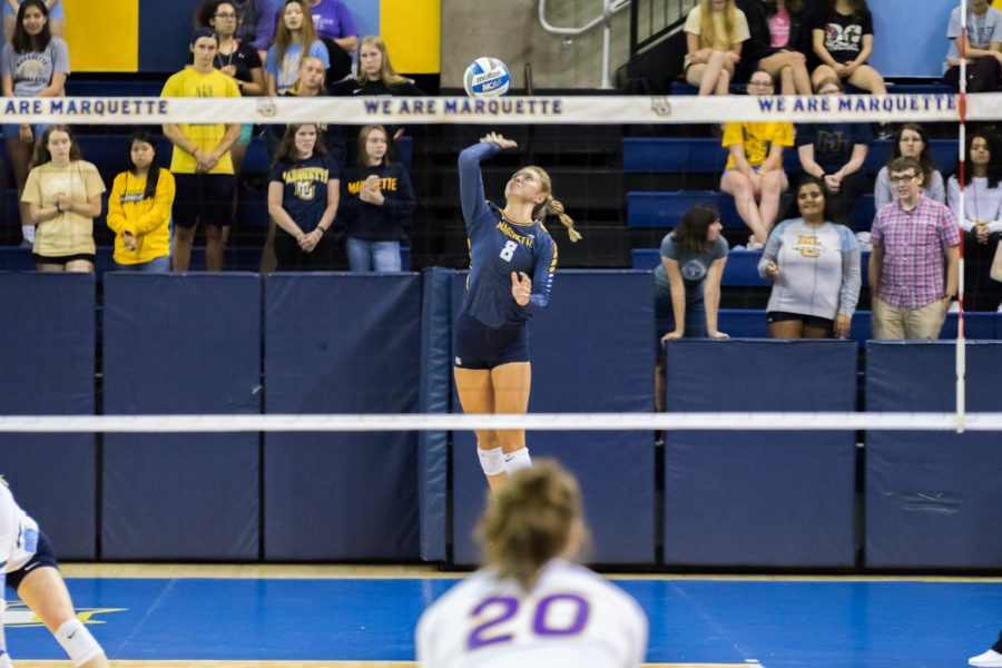 Hope Werch (8) serves the ball in a match against University of Northern Iowa last season.