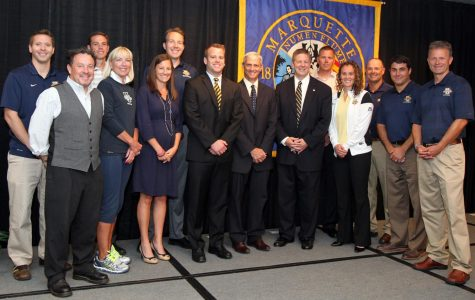 The Marquette coaches stand together at the press conference for then-new athletic director Bill Scholl in 2014.(Photo courtesy of Marquette Athletics.)
