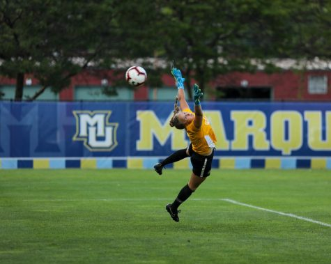 Mikki Easter dives for a ball Aug. 14, 2019. (Photo courtesy of Marquette Athletics.)