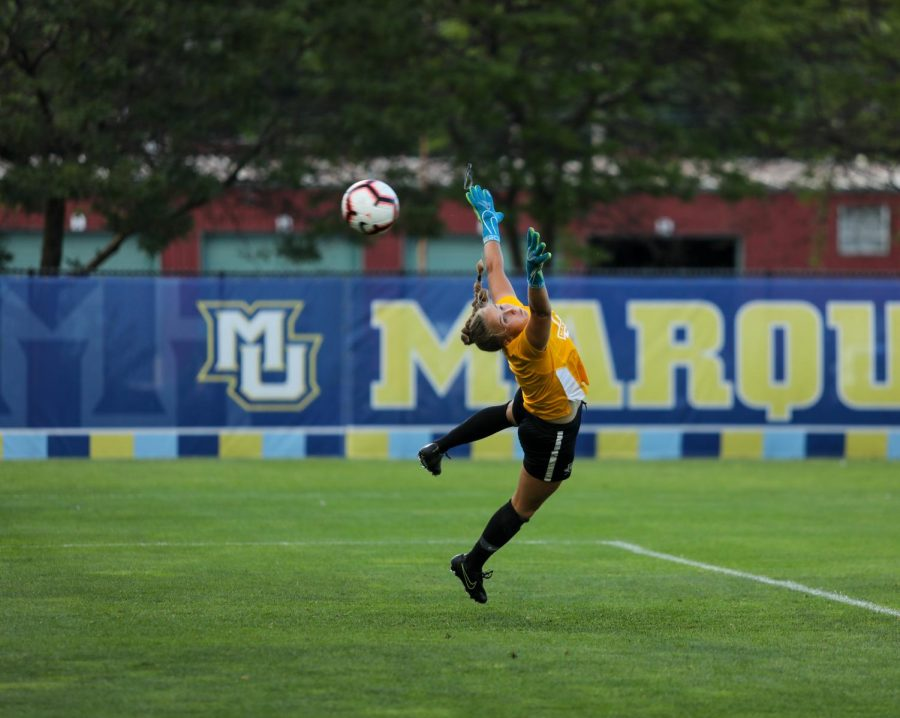 Mikki+Easter+dives+for+a+ball+Aug.+14%2C+2019.+%28Photo+courtesy+of+Marquette+Athletics.%29